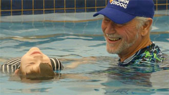 Chris Shapland and student during swimming lesson